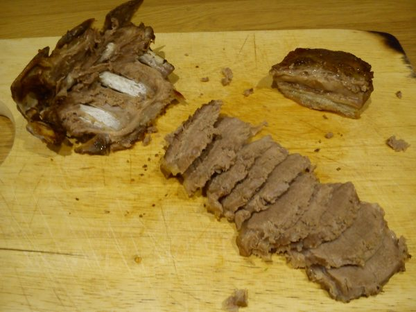 The loin separated from the bone with the fillet piece at top right-hand corner.